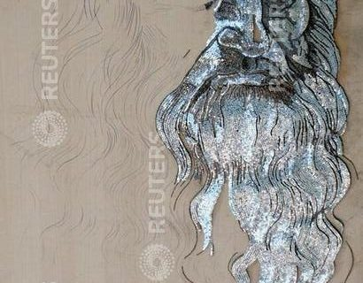 A portrait of Leonardo Da Vinci, created by artist Saimir Strati using industrial nails, is displayed at the International Centre of Culture in Tirana August 23, 2006. Strati, 40, is using some 500,000 industrial nails on a 8 sq m wooden board to create what he hopes will be entered in the Guinness World Records as the largest 3-D nail mosaic ever attempted. The work will take around 25 days to complete.     REUTERS/Arben Celi (ALBANIA)